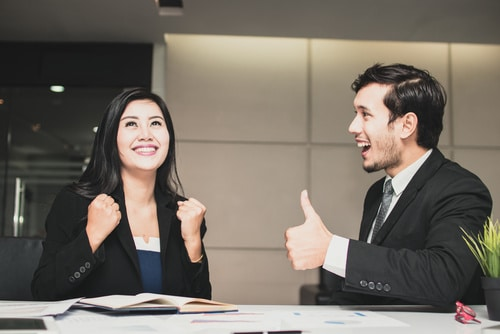 Asian business woman celebrate and business man admiring for suc