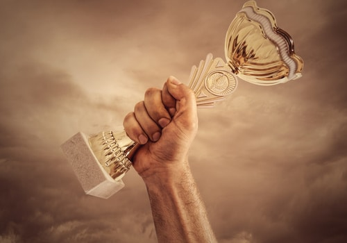 trophy being held by a hand