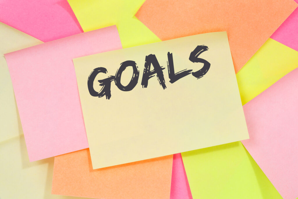 Goal goals to success aspirations and growth business concept note paper notepaper