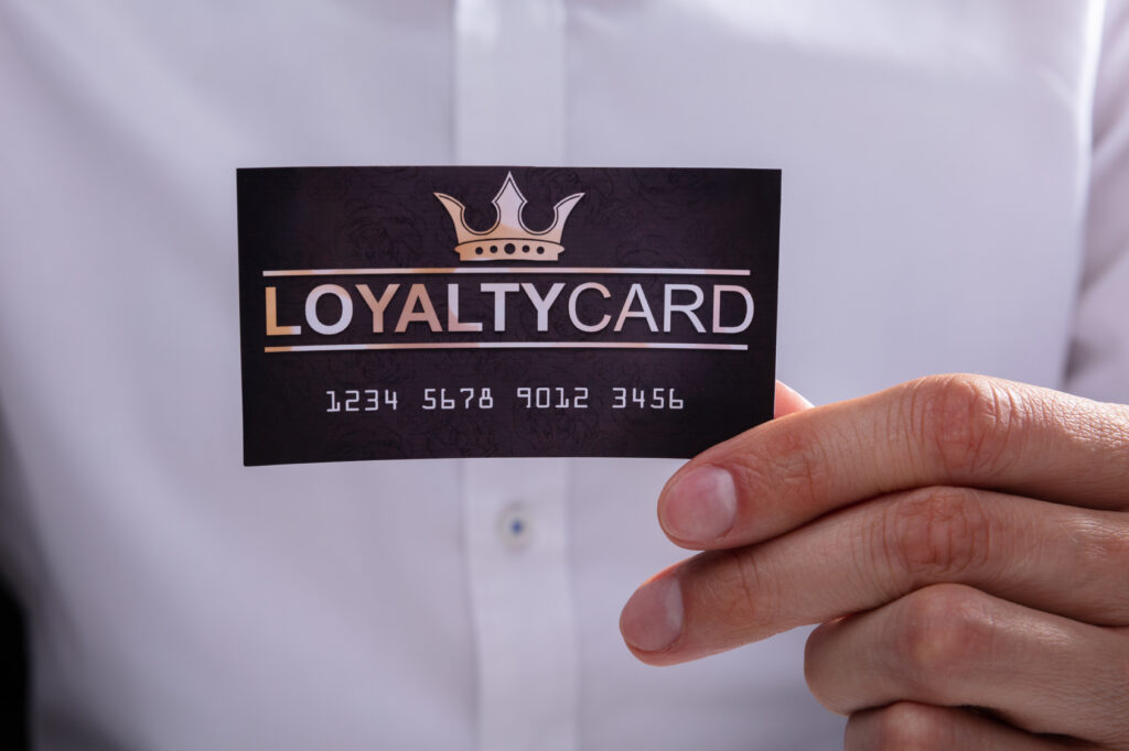 Businessman Holding Loyalty Card