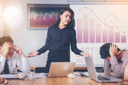 Serious woman boss scolding marketing team employee for bad busi