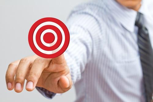 Business man pressing on target goal