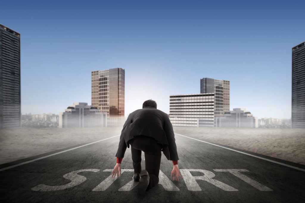 Asian business person ready to run toward the city. Business opportunity concept