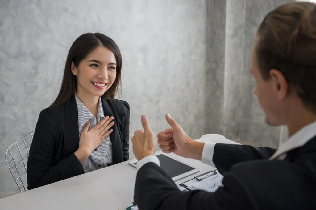 Business people co-workers are looking at each other with smile after success contract accept.Success business concept.